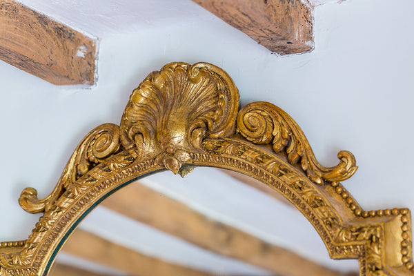 Antique French gilt gesso oval mirror top shell detail