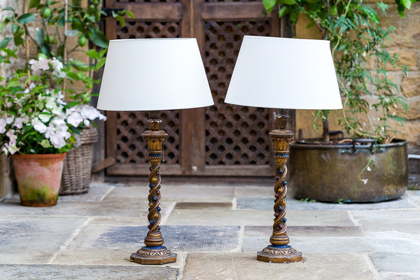 Offbeat Interiors - A Pair of Polychrome and Gilt Painted Lamps