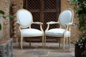 Offbeat Interiors - A pair of French painted fauteuils