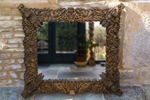 Offbeat Interiors - Carved gilt wood framed wall mirror