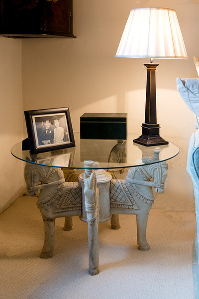 Offbeat Interiors - A pair of marble horse head tables