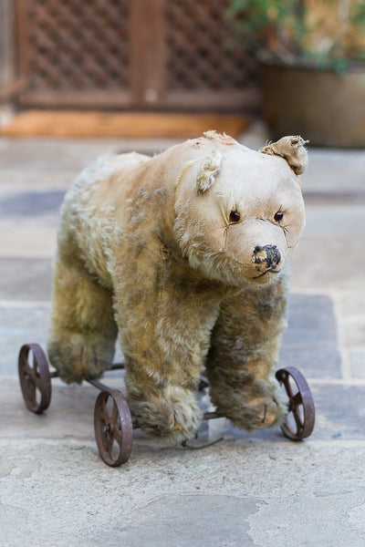 Offbeat Interiors - 20th Century Bear on Cast Iron Wheels