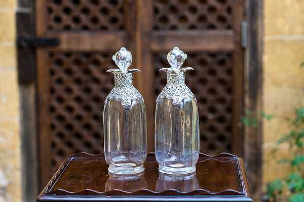 Offbeat Interiors - A Pair of Victorian Silver Mounted Decanters and Stoppers