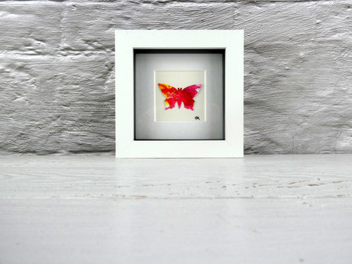 One framed butterfly (red)