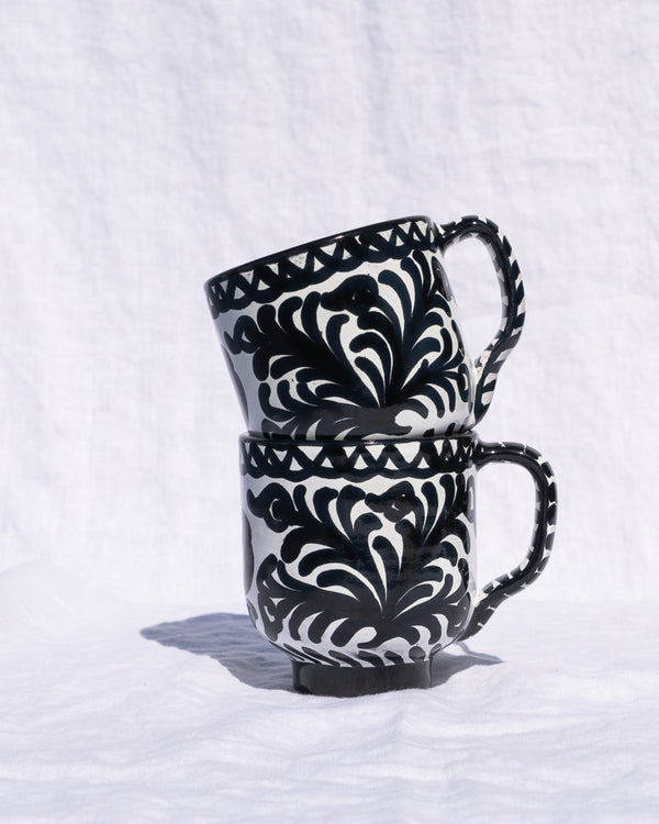 Mug with hand painted designs