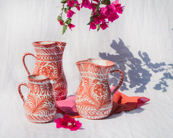 Medium pitcher with hand painted designs