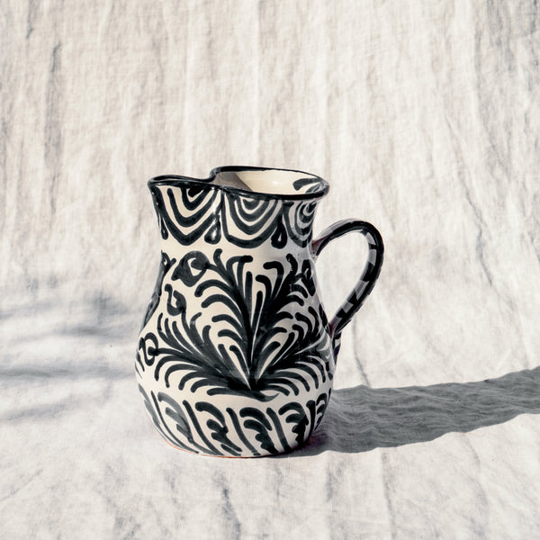 Small pitcher with hand painted designs