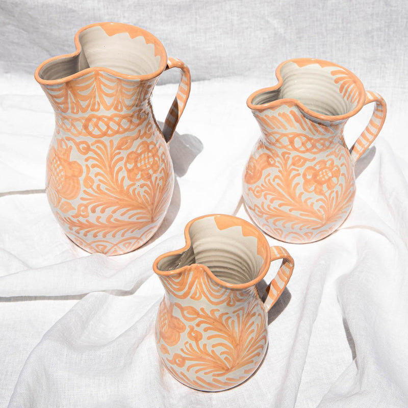 Large pitcher with hand painted designs