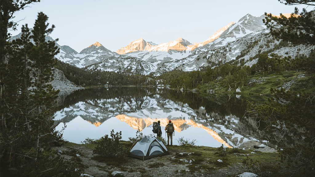 Tent-Set-up-By-Lakes-Surrounded-By-Mountains