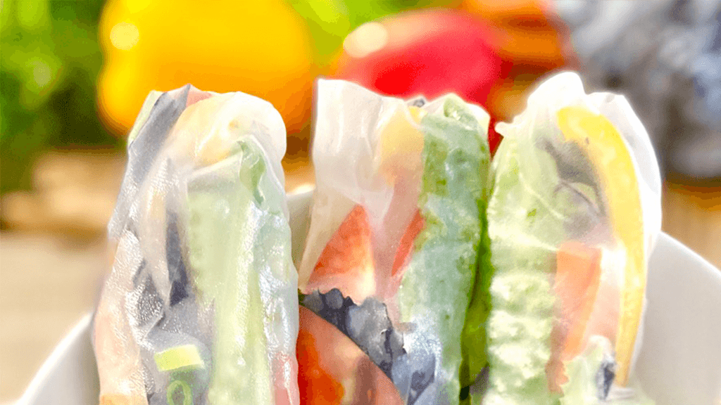 Tops-of-summer-rice-wrap-rolls -with-colourful-veggies-in-background