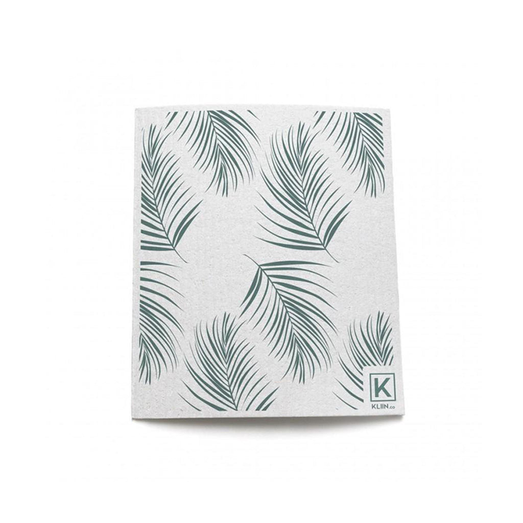 Single sheet of reusable paper towel that has a palm leaf pattern.