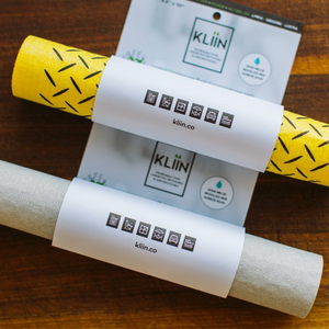 Grey and yellow reusable paper towel rolls in packaging.
