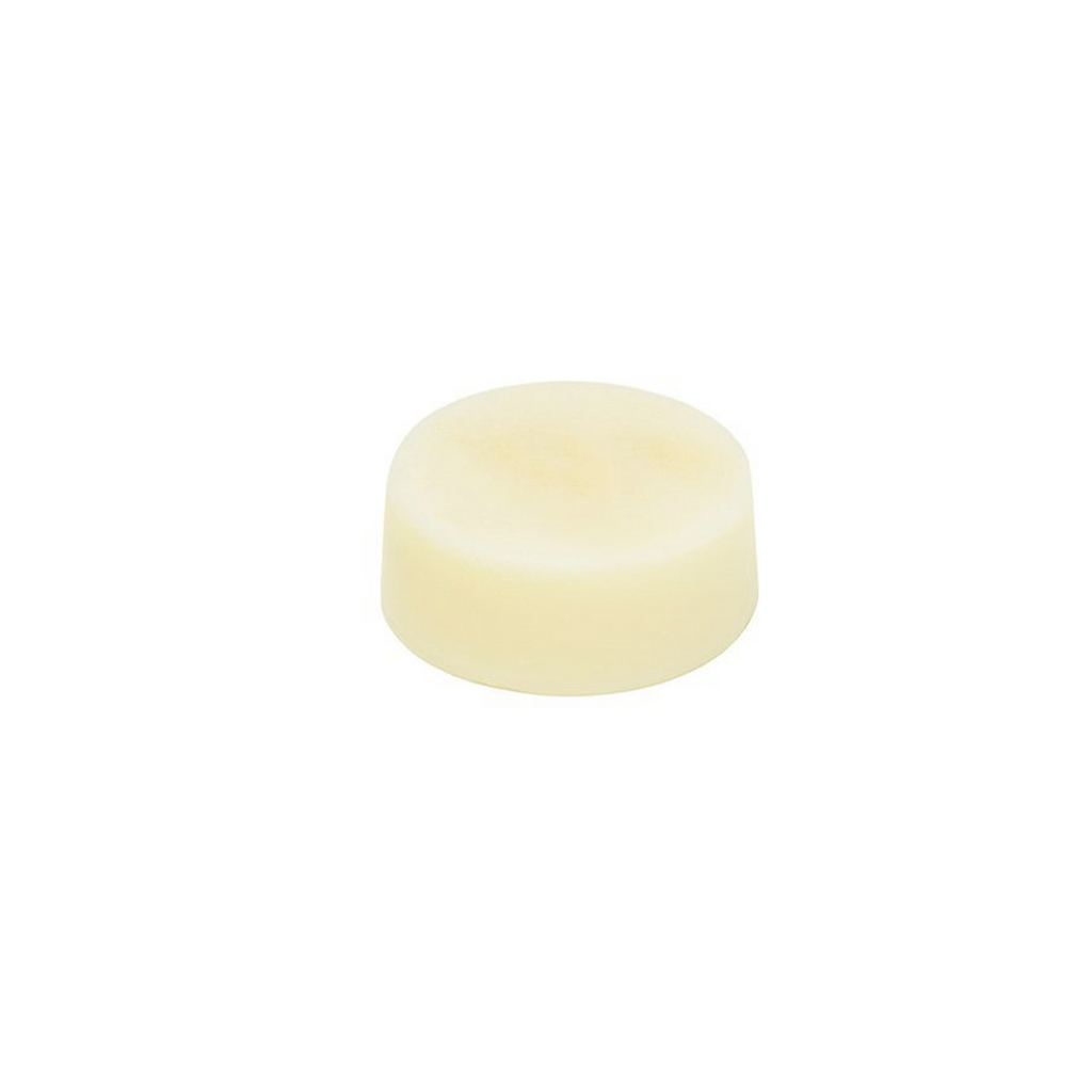 Light yellow solid conditioner bar on white background.