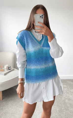Model shot of Glamify Adalyn knitted blue vest top styled over a white shirt