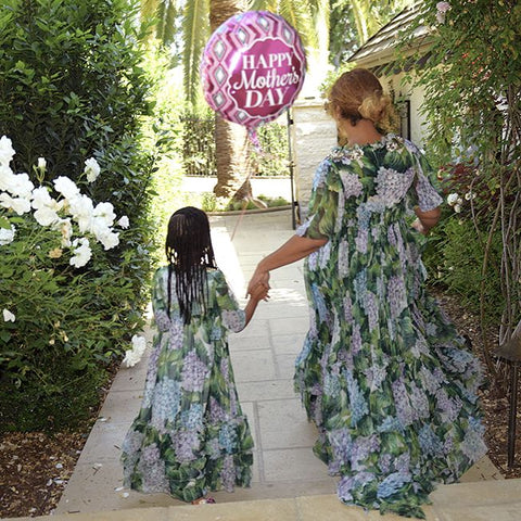 Beyonce and Blue Ivy wearing matching maxi dresses