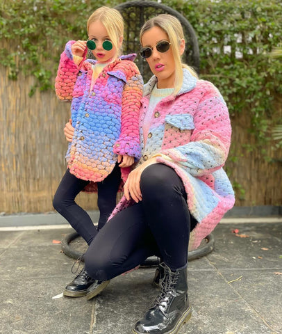 Mother and daughter model shot, wearing matching Glamify Kiara multicoloured shackets and sunglasses