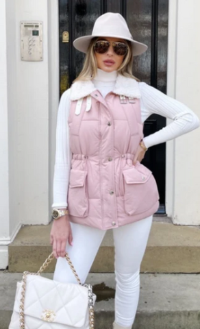 Model stood outside wearing Glamify Laurie  gilet in pink with cream faux fur.