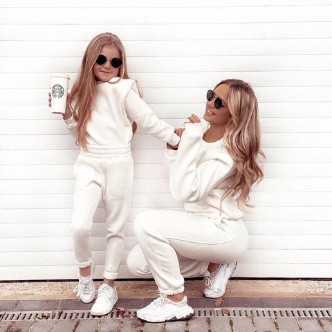 Mother and daughter model shot wearing matching Glamify Layla tracksuits in white