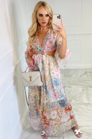 Model wearing Glamify Melody floral maxi dress and holding a white handbag