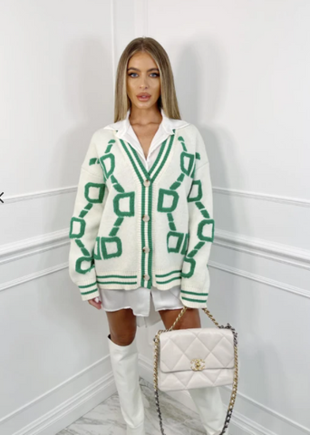 Model wearing Sandi ecru & green chain print oversized cardigan with cream boots and a Chanel bag
