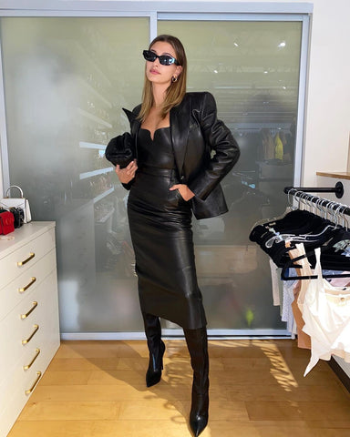 Hailey Bieber Baldwin posing in a full black leather outfit with sunglasses on