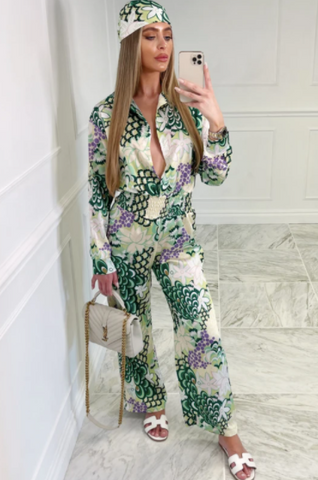 Model wearing Glamify Amazon printed green jumpsuit with matching headscarf