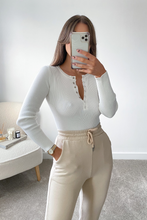 Load image into Gallery viewer, MISHA Cream Long Sleeve Ribbed Popper front Bodysuit