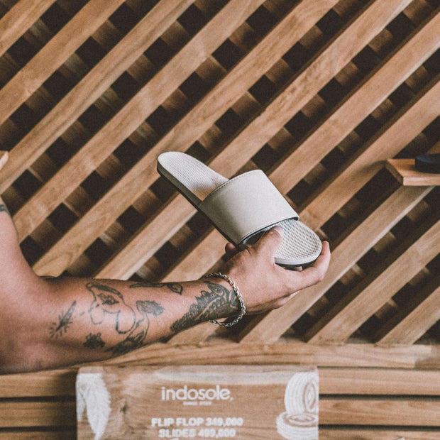 Man holding sea salt slides in Indosole's flagship store in Canggu, Bali