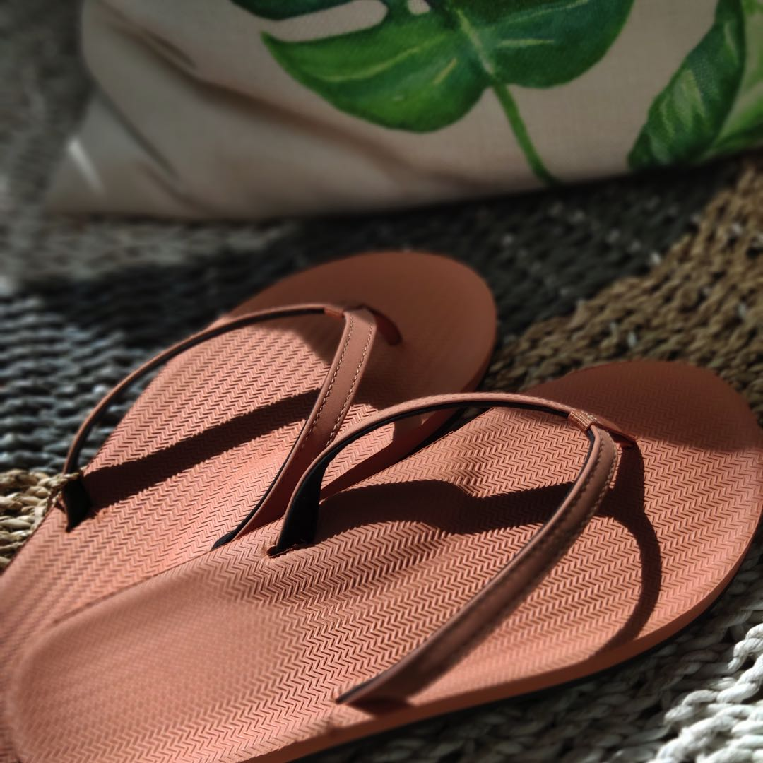Rust flip flops with sunlight over them