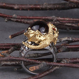 Bague dragon chateau