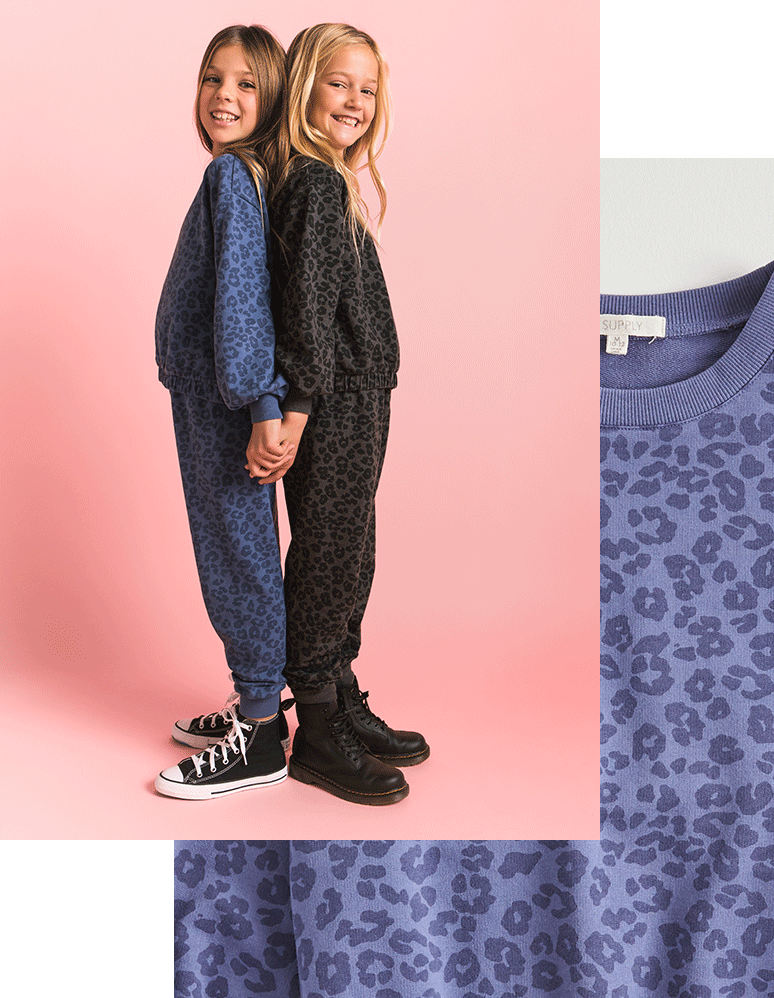 The Girls Carmen Leopard Sweatshirt and Girls Ava Leopard Jogger in matching sets. Available in black, vintage blue, and bone.