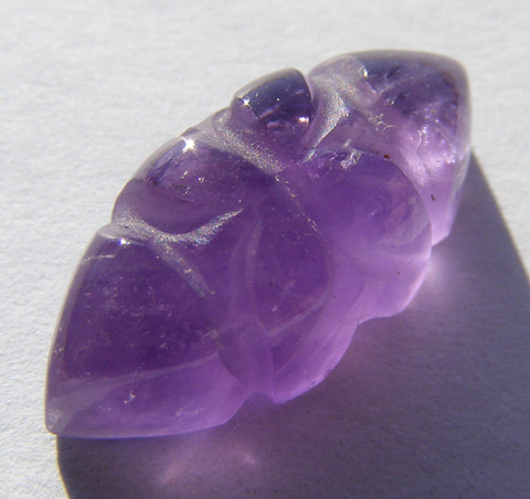 Carved Amethyst Marquise Cab