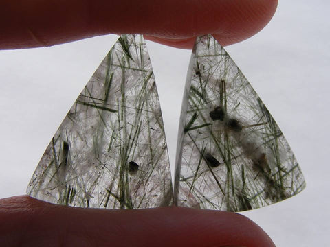 Green Rutile Quartz Triangular Cabs.