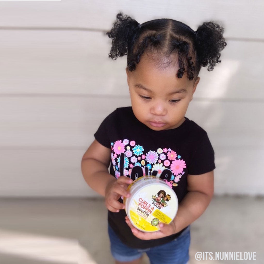 Little Curly Hair Girl Holding FroBabies Hair Product