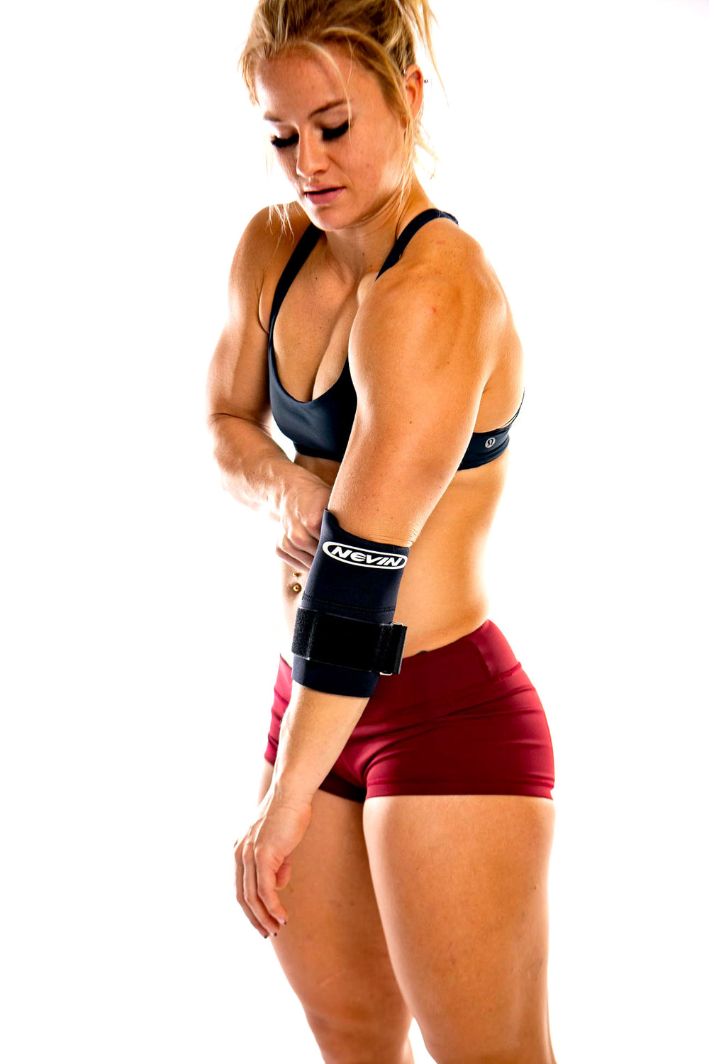 athlete putting on contoured elbow support