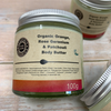 organic body butter by heavenly organics with orange, rose geranium and patchouli in glass jar and metal cap