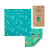blue and green beeswax wrap sheets with seagulls boats and marine life
