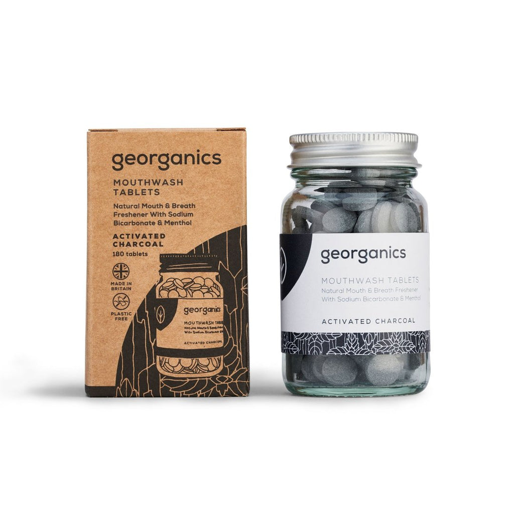eco friendly mouthwash tablets made with activated charcoal in  plastic free glass jar and brown recycling box