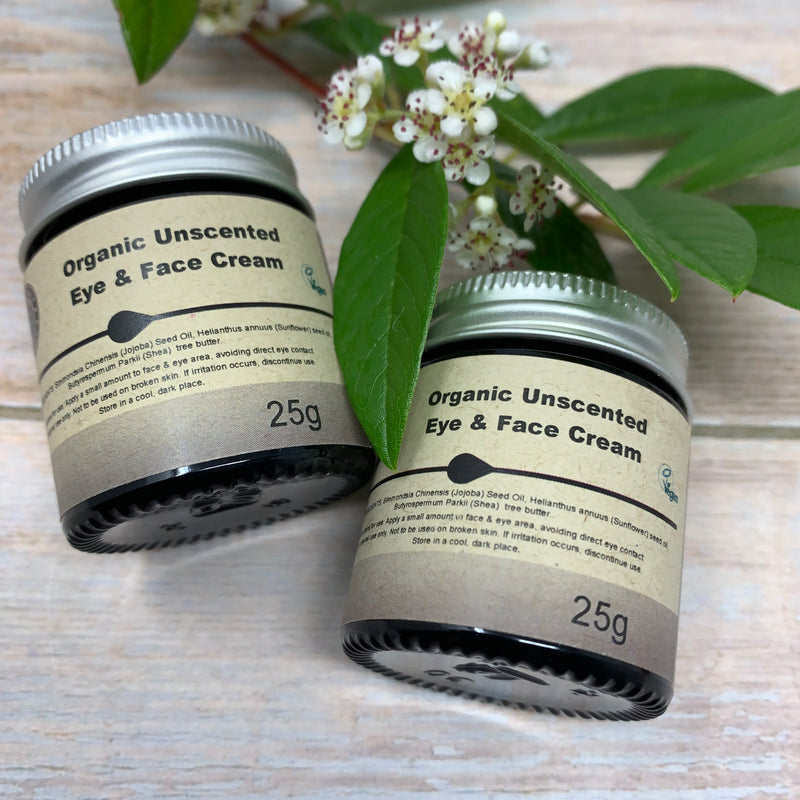 two jars of organic unscented eye and face mask by heavenly organics, inside glass jars with aluminium cap and paper label