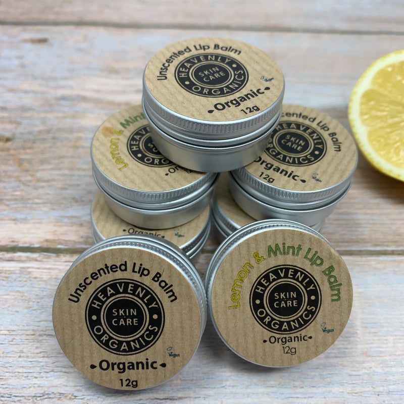 Many lip balms with plastic free packaging, some are scented with lemon and mint, and some unscented, all in reusable metal packaging.