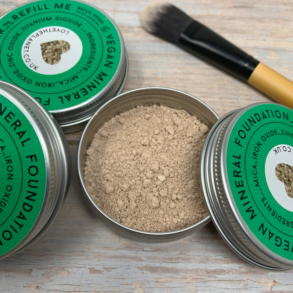 fair coloured mineral foundation powder in a reusable metal jar with vegan foundation brush