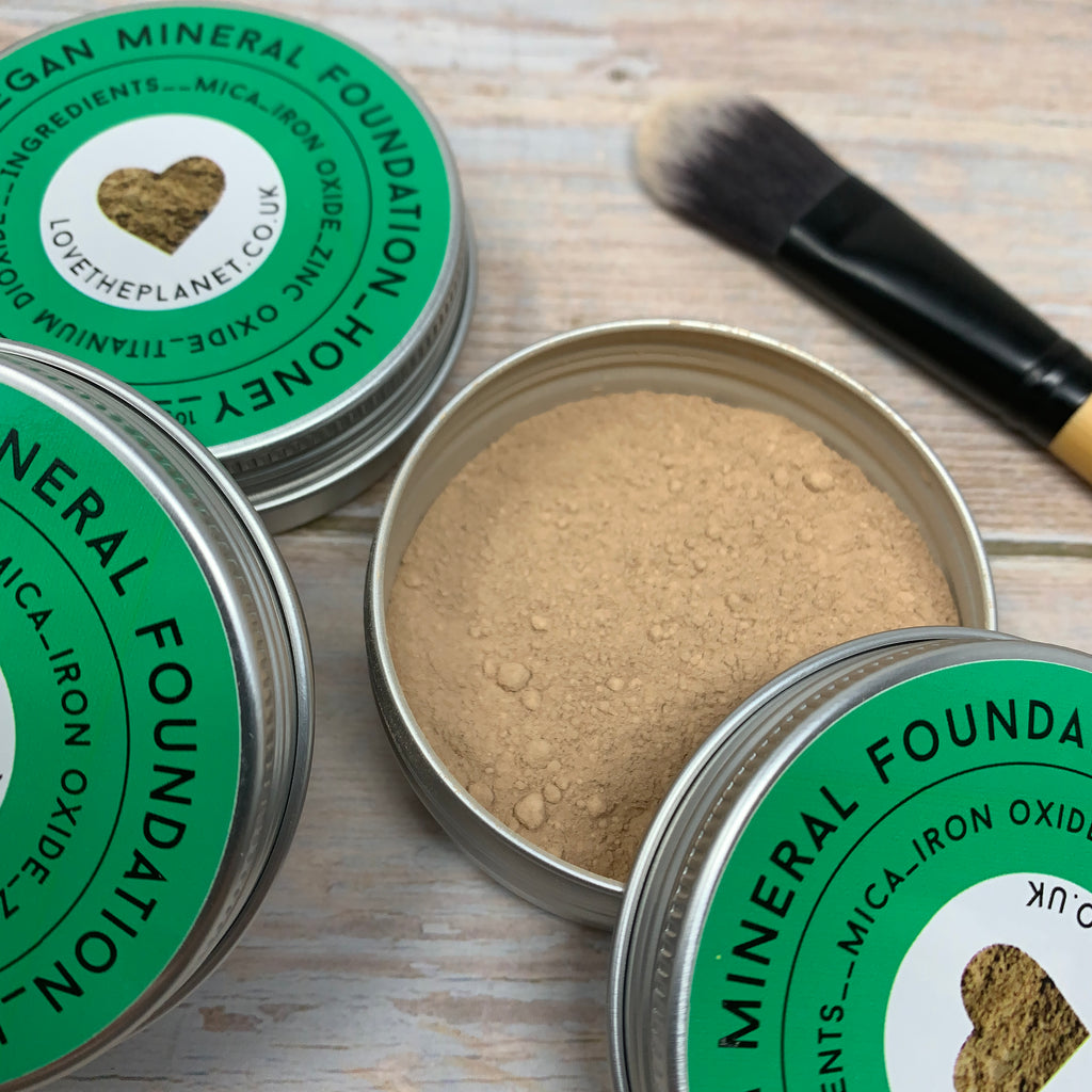 cruelty free foundation powder honey coloured in round aluminium container and foundation brush with vegan bristles