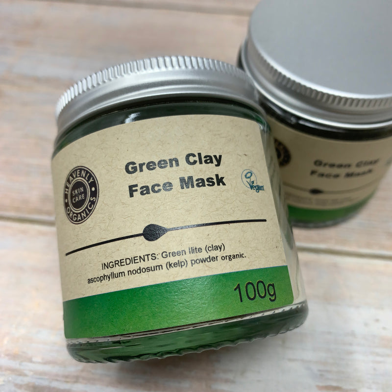 green clay face mask by heavenly organics with closeup of ingredient list on the jar label