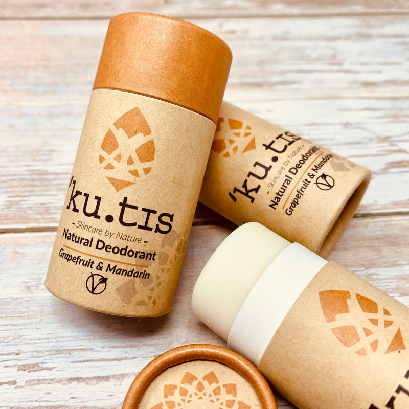 vegan deodorant packed in recyclable cardboard packaging by kutis on a wooden background