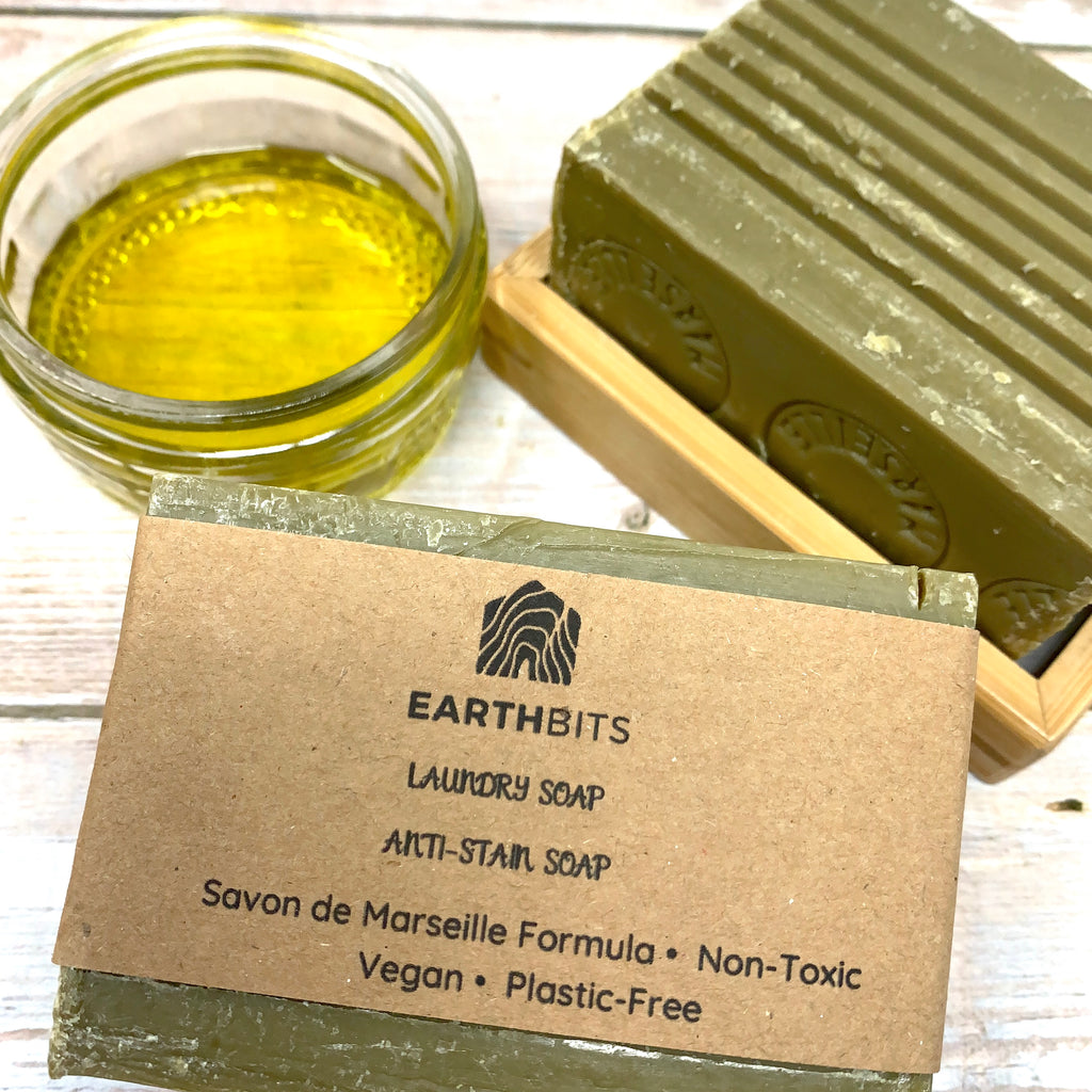 olive oil savon de marseille anti stain soap bar with brown paper label on bamboo dish