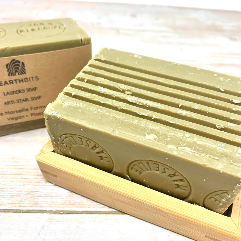 green savon de marseille bar for laundry with earthbits brown paper label and bamboo soap rack