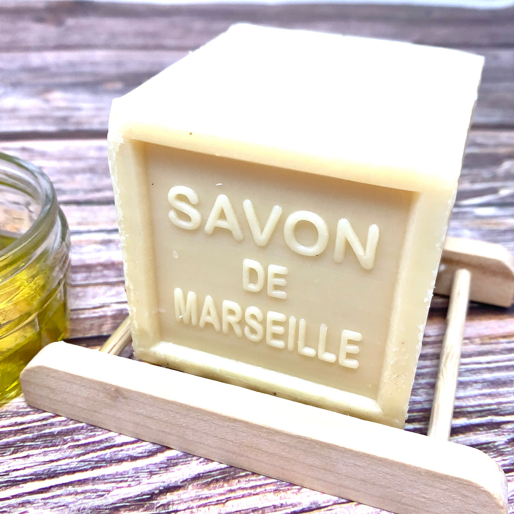 savon de marseille cube  made with natural ingredients on bamboo soap dish
