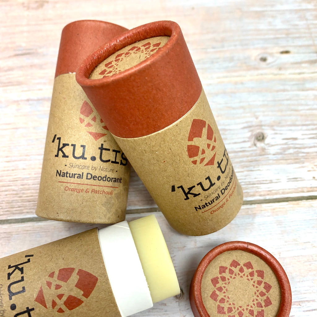kutis natural vegan deodorant in brown paper tube stick and red cap made with orange and patchouli