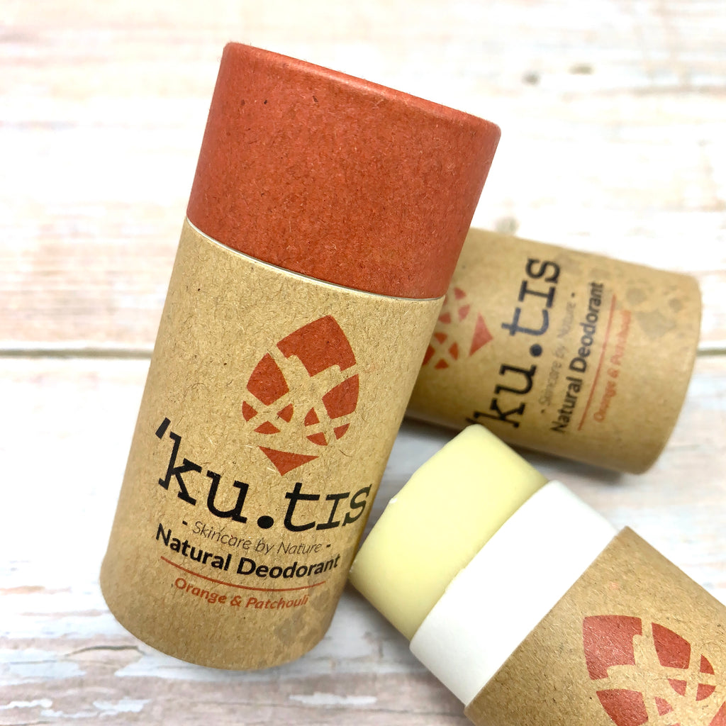 orange and patchouli natural deodorant in paper tube