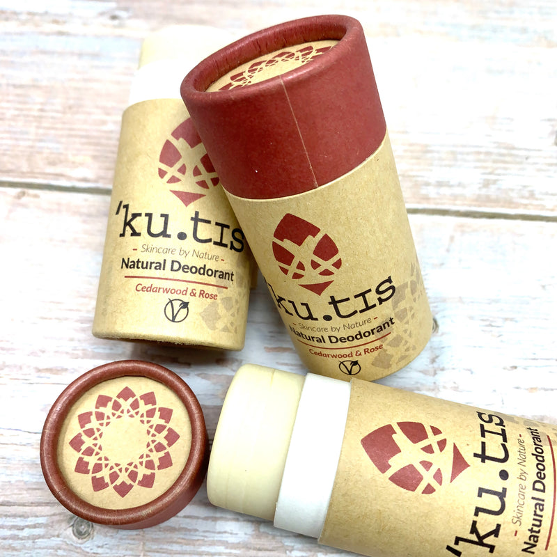vegan deodorant stick in paper push up tube made with brown and magenta cardboard